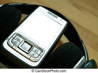 Mobile audio - A mobile phone arranged with a set of...