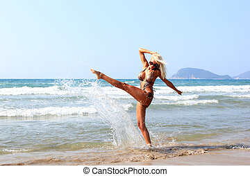 Young beautiful woman on a beach