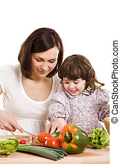 mother and daughter cooking at the kitchen - mother and...