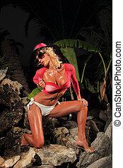 Woman wearing a bikini posing in the summer