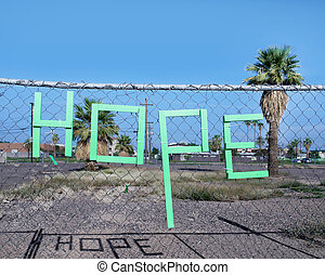 Hope, spelled out in letter form on fence in down town Los...