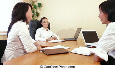 Casual Business Discussion - Three Business Women are...