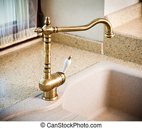 Vintage faucet in a kitchen sink