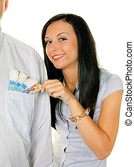 woman pulls a man out of his pocket swiss francs - young...