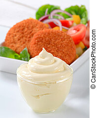 Fried cheese with vegetable salad and mayonnaise - Fried...