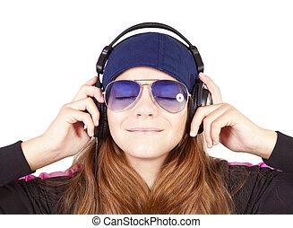 girl listening music by headphones over white
