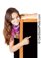 smiling girl pointing blackboard isolated over white