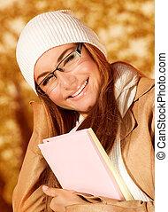 Student female in autumn park