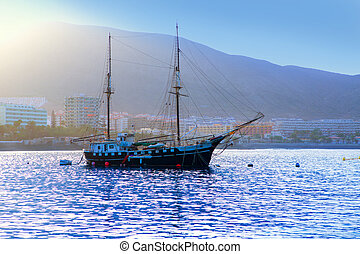 Los Cristianos harbor port sailboat sunrise in Adeje coast...