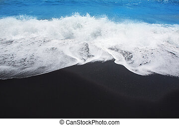 Black sand beach in Tenerife at Canary Islands - Black sand...
