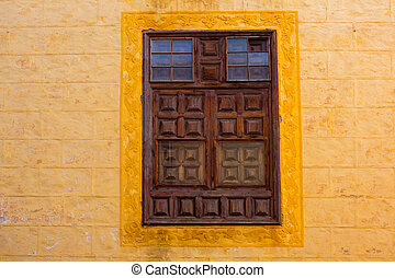 La Orotava wooden window in yellow wall Tenerife at Canary...