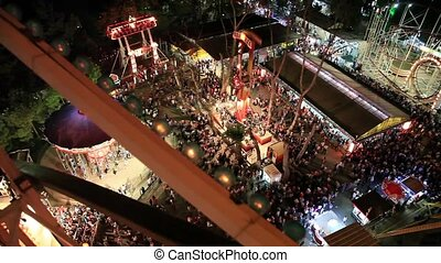 amusement park and crowded people