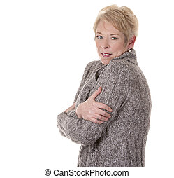 woman cold - casual blond woman in her fifties is cold on...