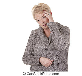 woman with headache - casual blond woman in her fifties...
