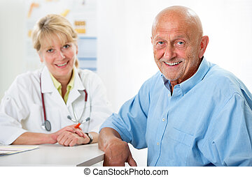 Medical exam - Happy senior patient and doctor at the...