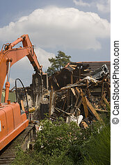 Flood Damaged home being torn down in New Orleans. - A flood...