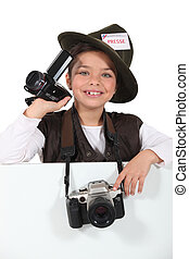 Girl with a camera and camcorder