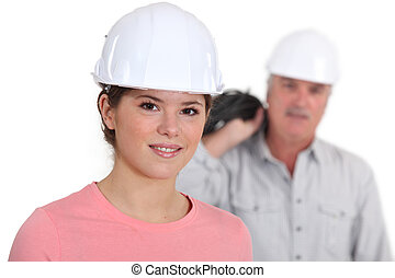 Portrait of a young tradeswoman with her boss in the...