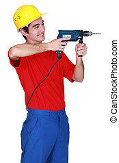 Young person wielding a power drill