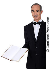 Middle-aged waiter holding menu