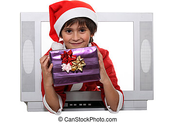 Little boy dressed as Santa escaping from television set