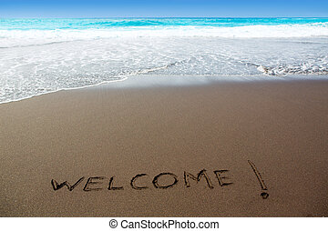 Brown sand beach with written word Welcome in Canary Islands