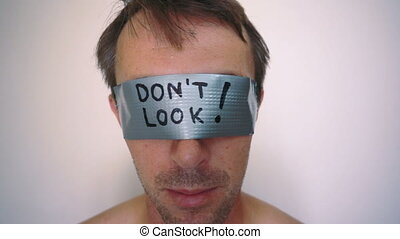 See No Evil Duct Tape - Close up facial shot of a man with...