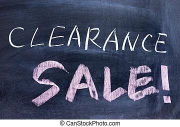 Clearance sale words written on the chalkboard