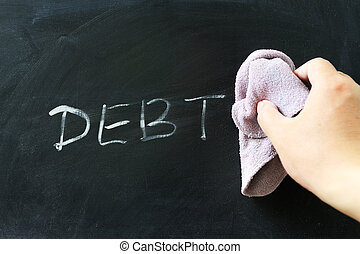 Wiping off debt - Hand wiping off debt word using rug