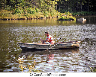 fishing boat - A young man fishing out of a row boat