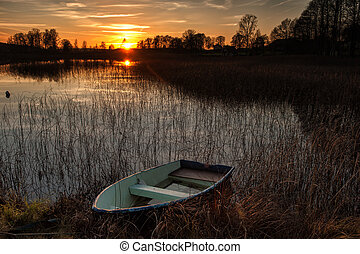 Autumn sunset at a lake in Ostergotland, Sweden