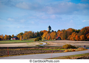 Autumn in Scandinavia - Winding road at autumn in...