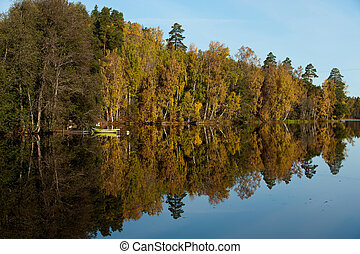 Autumn in Scandinavia - Tranquil October morning at a lake...