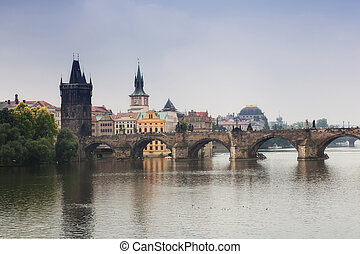 Prague, view of the Vltava River and bridges in a morning fog