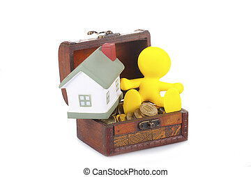 toy yellow little man sits on a chest with money and the...