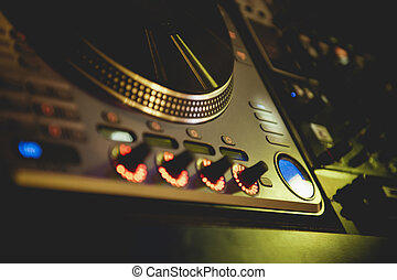 DJ turntable in nightclub - DJ mixing desk in nightclub...