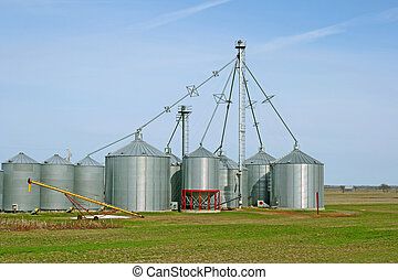 Grain silos on a farm in spring - Grain silos on a farm in...