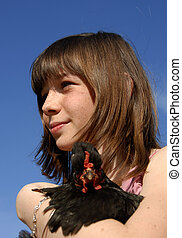 young girl and chicken