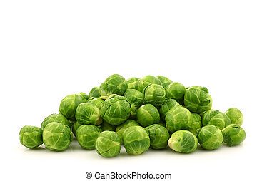 Freshly harvested Brussel sprouts on a white background