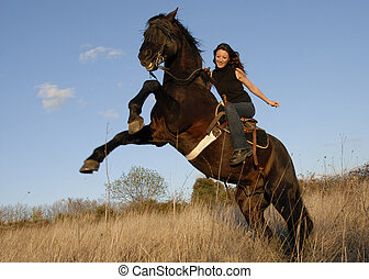 rearing stallion and girl