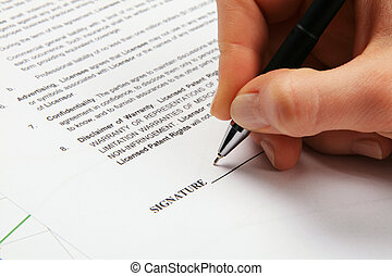 Signing a generic license agreement, closeup view