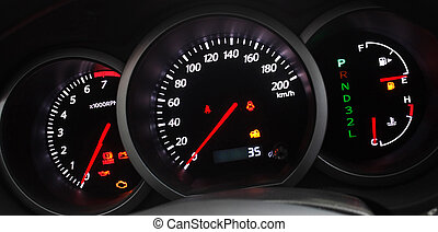 Illuminated Car Dashboard - Car Dashboard closeup with...
