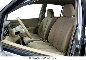 Front seats of a modern car, light leather.