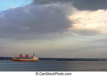 Cargo vessel in a bay