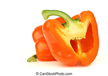 cut orange bell peppercapsicum on a white background