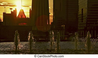 Fountain - The jets of the fountain in backlight of sunset