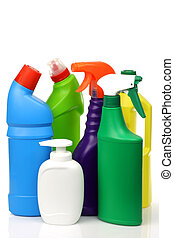 plastic cleaning bottles in various colors on a white...