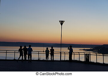People watch the sunset