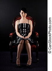 Beautiful woman - A portrait of a beautiful woman sitting on...