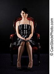 Beautiful woman - A portrait of a beautiful woman sitting on...